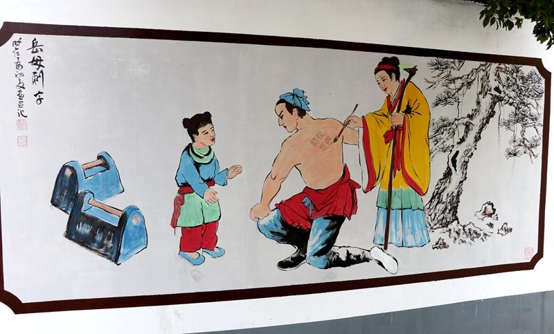 手绘文化墙成为驻马店市区一道亮丽的风景线